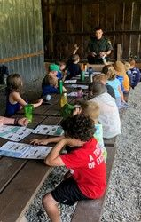 ECO Kostuk teaching campers how to identify fish