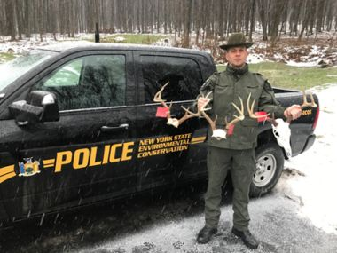ECO Damrath with the illegally taken trophy racks