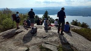 hikers at the top of an Adirondack peak