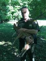 Lt. Dave McShane with the fawn