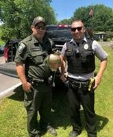 ECO McCormick, Broome County Security Officer Dewing, and goose